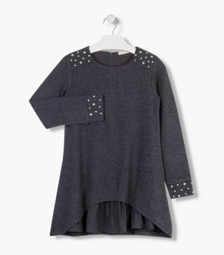 Black dress with star motifs.