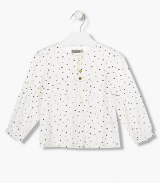All-over heart and star print blouse.