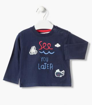 T-shirt featuring embroidered bear and whale patches.