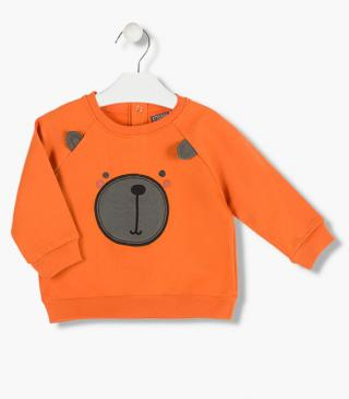 Print front sweatshirt with a bear patch.
