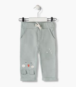Penguin print trousers with little leg appliqué.