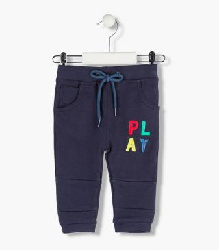 Trousers with graphic patches on the leg.