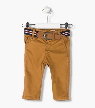 Amber twill trousers with a belt.